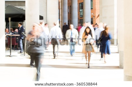 Business people blur. People walking in the City of London, business and financial aria - stock photo