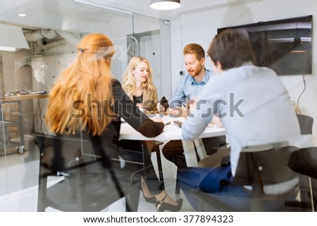 Business people board meeting in modern office while sitting at round table