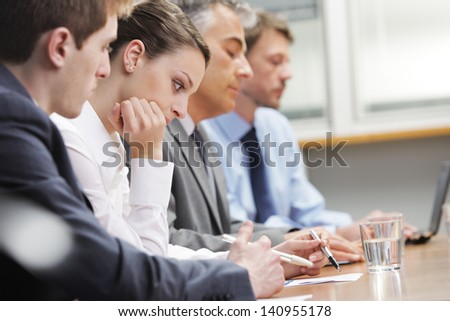 Business people bored during a meeting - stock photo