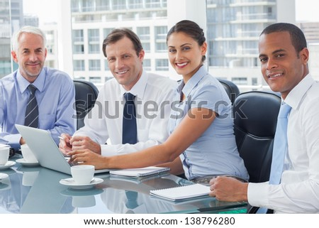 Business people brainstorming in the meeting room - stock photo