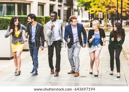 Business people challenging each other. Young businessmen and businesswomen looking each other before a race. Mixed race group. Teamwork and business concepts.