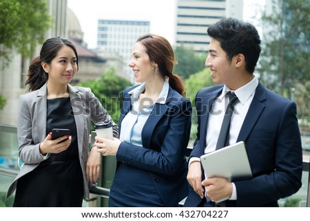 Business people chatting at outdoor