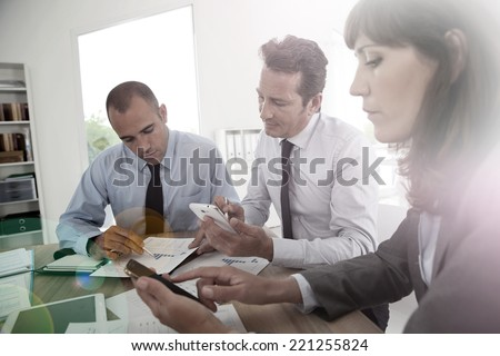Business people checking on smartphone to book meeting time - stock photo