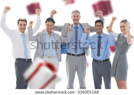 Business people cheering in office against white and red gift box - stock photo