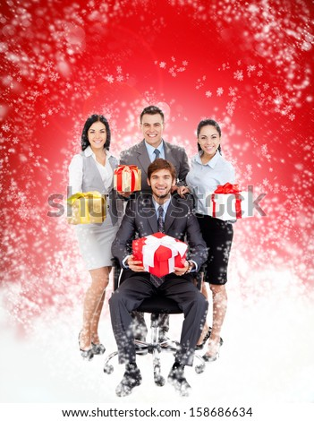 Business people Christmas group team hold gift box presents, man leader in chair, businesspeople smile, over abstract magic winter background with sparkles blowing snow concept corporate holiday - stock photo