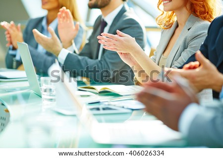 Business people clapping at conference - stock photo
