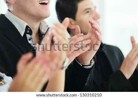 Business people clapping hands during meeting at office or presentation - stock photo