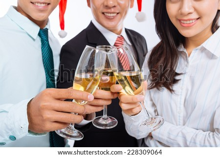 Business people clinking glasses of champagne - stock photo