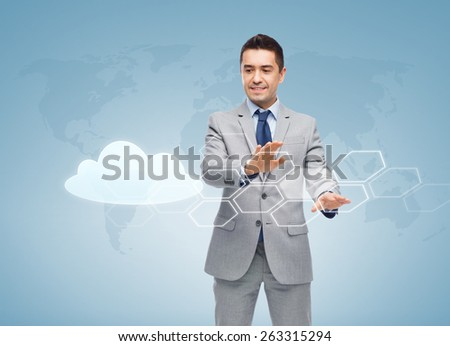 business, people, cloud computing and technology concept - happy smiling businessman in suit working with virtual screens over blue background - stock photo