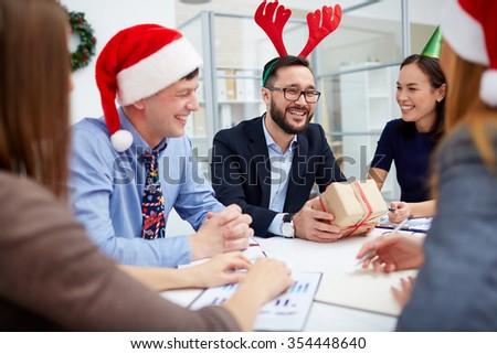 Business people communicating at Christmas meeting - stock photo