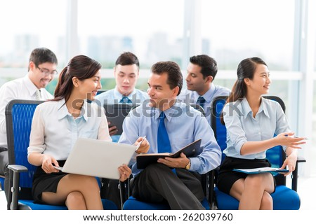 Business people communicating at conference - stock photo