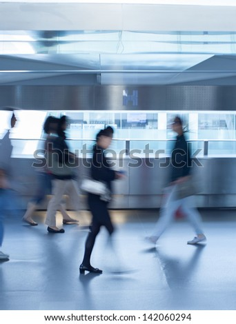Business people commuting (abstract blurred motion) - stock photo