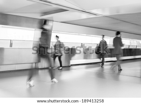 Business people commuting, abstract blurred motion. - stock photo