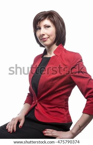 Business People Concepts and Ideas. Portrait of Confident Caucasian Business Brunette Woman Posing in Red Suit Against White. Vertical Image Composition