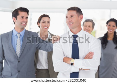 Business people congratulating their colleague in the office - stock photo