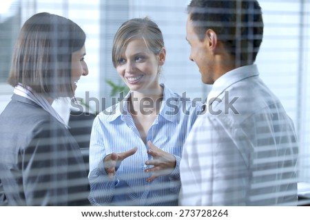 Business people conversing in office - stock photo