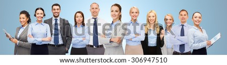 business, people, corporate, teamwork and office concept - group of happy businesspeople over blue background - stock photo