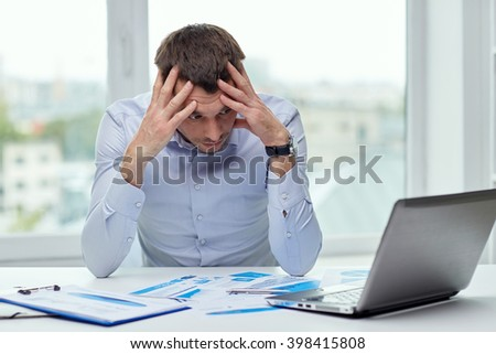 business, people, deadline and technology concept - stressed businessman with laptop computer and papers at office
