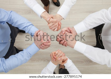 Business people  demonstrating a gesture of a strife or solidarity, view from above