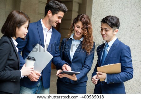 Business people discuss about on tablet - stock photo