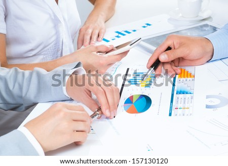 business people discuss meeting targets, sitting at the business table with documents