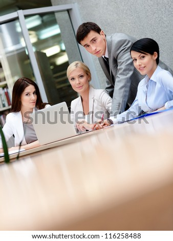 Business people discuss something at the conference at the modern office building. Team works successful - stock photo