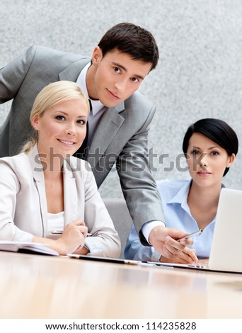 Business people discuss something at the meeting at the modern office building