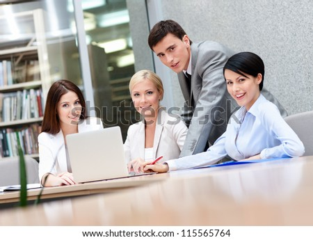 Business people discuss something at the meeting at the modern office building. Success concept - stock photo