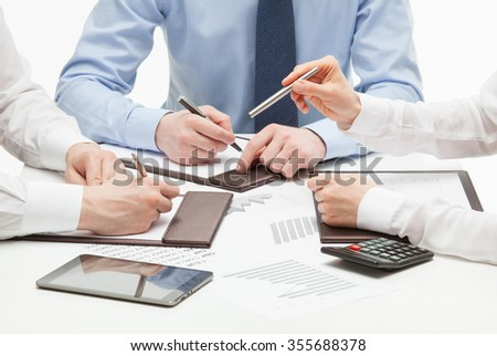 Business people discussing a new project, white background - stock photo
