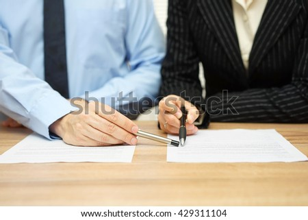Business people discussing about contract, manager pointing on content in document - stock photo