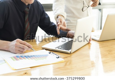 Business people discussing and analyze   data chart. Teamwork brainstorming about the successful business - stock photo