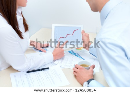 Business people discussing and consulting about the success sales using a digital computer. - stock photo