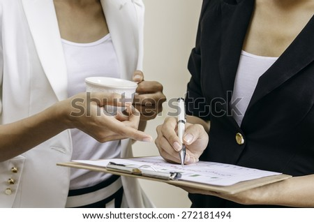 business people discussing and making a gesture