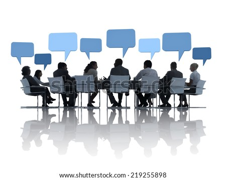 Business People Discussing Around The Conference Table And Speech Bubbles Above Them. - stock photo