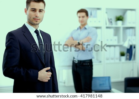 Business people discussing at business meeting, in office - stock photo
