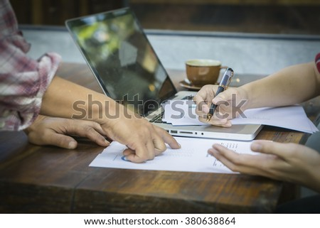 Business people discussing business strategy on the foreground, business partners hands during discussion of financial and business documents meeting Analizing  Financial Data and Charts in the Office - stock photo