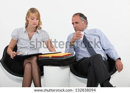 Business people discussing documents - stock photo