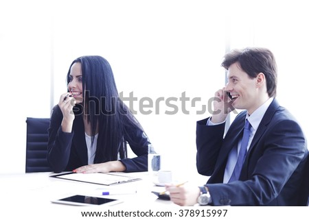 Business people discussing financial reports during a meeting