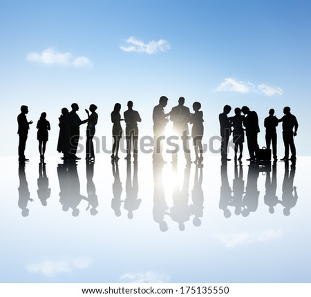 Business People Discussing Silhouettes - stock photo