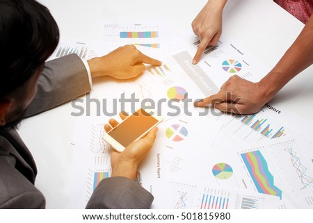 business people discussing the charts and graphs showing the results of their successful teamwork, success together, analysis data concept