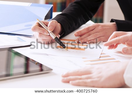 Business people discussing the charts and graphs. Successful teamwork concept - stock photo