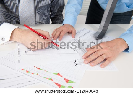Business people discussing the situation in the stock market - stock photo