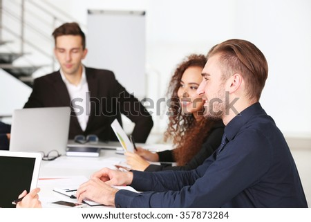 Business people discussing work in conference room