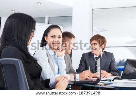 business people discussion on meeting sitting at desk in office, businessmen smile,  group businesspeople team communicate - stock photo