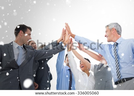 Business people doing hands checks against snow - stock photo