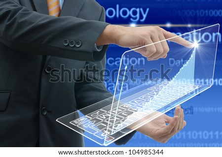 Business people drawing a graph by finger on glass laptop touch screen.