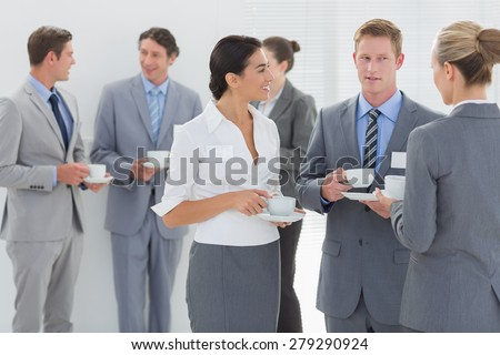 Business people drinking cup of coffee in the meeting room - stock photo