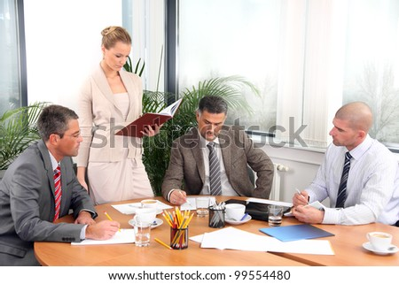 Business people during a meeting in office - stock photo