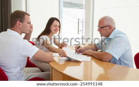 Business people during teamwork on a workplace - stock photo