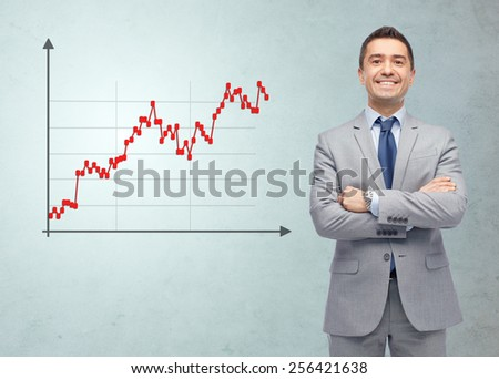 business, people, economics, stock market and finances concept - happy smiling businessman in suit with forex chart over gray background - stock photo